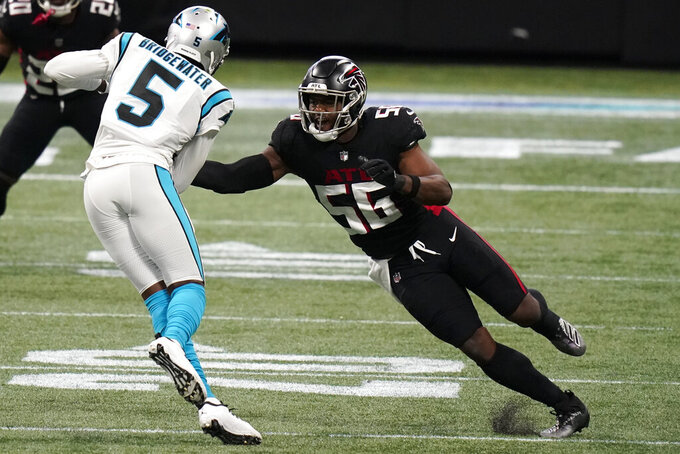 Atlanta Falcons defensive end Dante Fowler Jr. (56) misses the tackle on Carolina Panthers quarterback Teddy Bridgewater (5) during the first half of an NFL football game, Sunday, Oct. 11, 2020, in Atlanta. (AP Photo/Brynn Anderson)