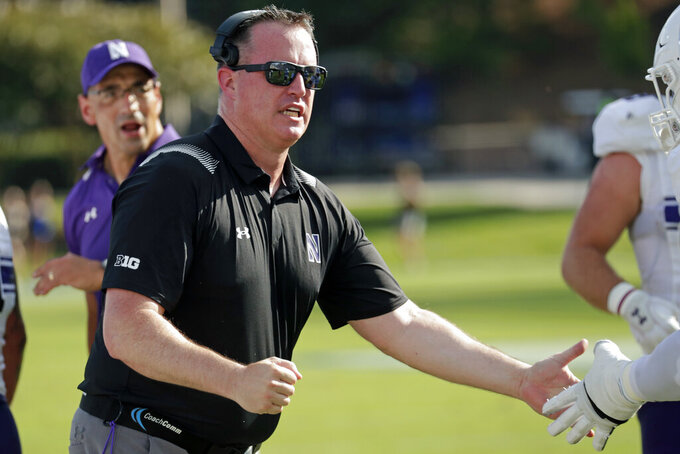 Northwestern head coach Pat Fitzgerald congratulates the players after they recovered a fumble against Duke during the first half of an NCAA college football game in Durham, N.C., Saturday, Sept. 18, 2021. (AP Photo/Chris Seward)