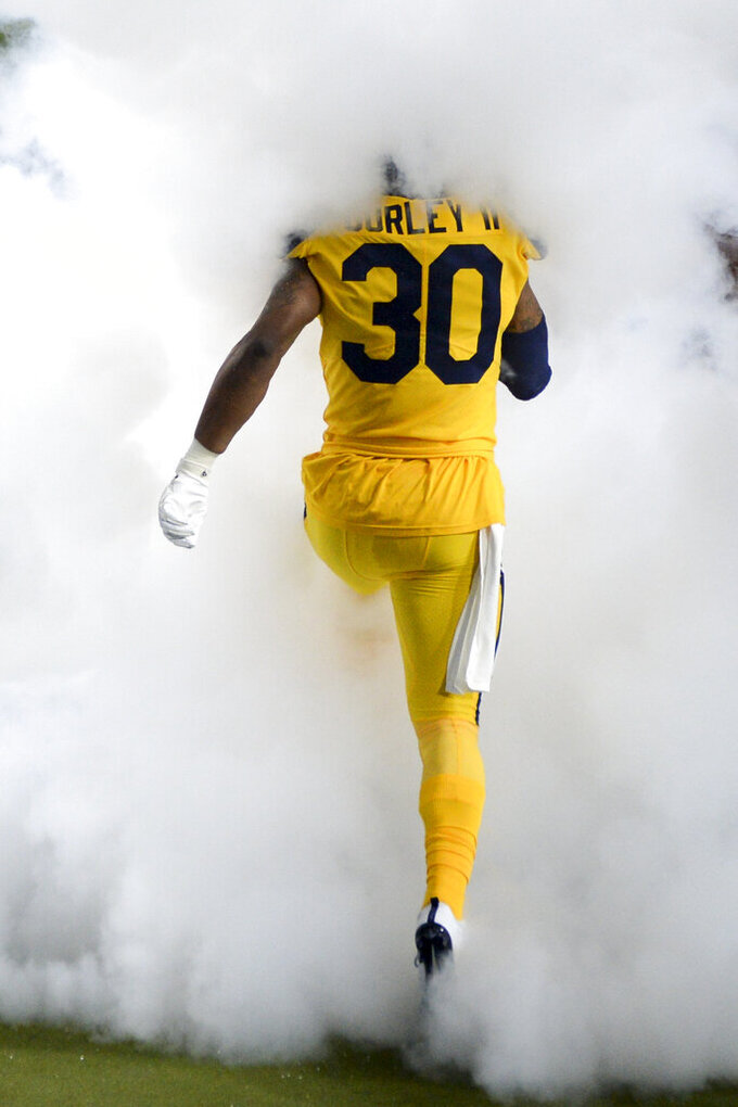 Los Angeles Rams running back Todd Gurley runs on to the field for an NFL football game against the Baltimore Ravens Monday, Nov. 25, 2019, in Los Angeles. (AP Photo/Kyusung Gong)