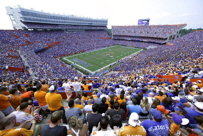 "FILE - This is a Sept. 17, 2011, file photo showing fans watching an NCAA college football game between Tennessee and Florida in Gainesville, Fla. Florida (6-2, 4-2 Southeastern Conference) begins a three-game homestand Saturday against Missouri (4-4, 0-4). The Gators also host South Carolina and Idaho over the first three weekends of November. The late-season stretch will go a long way toward determining which bowl game Mullen's team lands. It also will establish how many ""stadiums"" players will have to run after the season.(AP Photo/Phelan M. Ebenhack, File)"