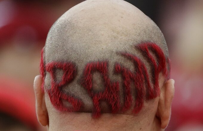 An Alabama fan watches warm ups before the NCAA college football playoff championship game against Clemson Monday, Jan. 7, 2019, in Santa Clara, Calif. (AP Photo/David J. Phillip)