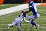 Cincinnati Bengals cornerback LeShaun Sims (38) attempts to tackle New York Giants running back Dion Lewis (33) during the first half of NFL football game, Sunday, Nov. 29, 2020, in Cincinnati. (AP Photo/Aaron Doster)
