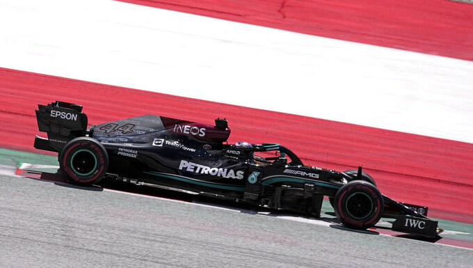Mercedes driver Lewis Hamilton of Britain steers his car during the third practice at the Red Bull Ring racetrack in Spielberg, Austria, Saturday, June 26, 2021. The Styrian Formula One Grand Prix will be held on Sunday, June 27, 2021. (AP Photo/Darko Vojinovic)