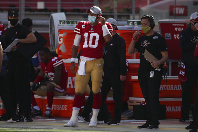 San Francisco 49ers quarterback Jimmy Garoppolo (10) stands on the sideline during the second half of an NFL football game against the Miami Dolphins in Santa Clara, Calif., Sunday, Oct. 11, 2020. (AP Photo/Jed Jacobsohn)