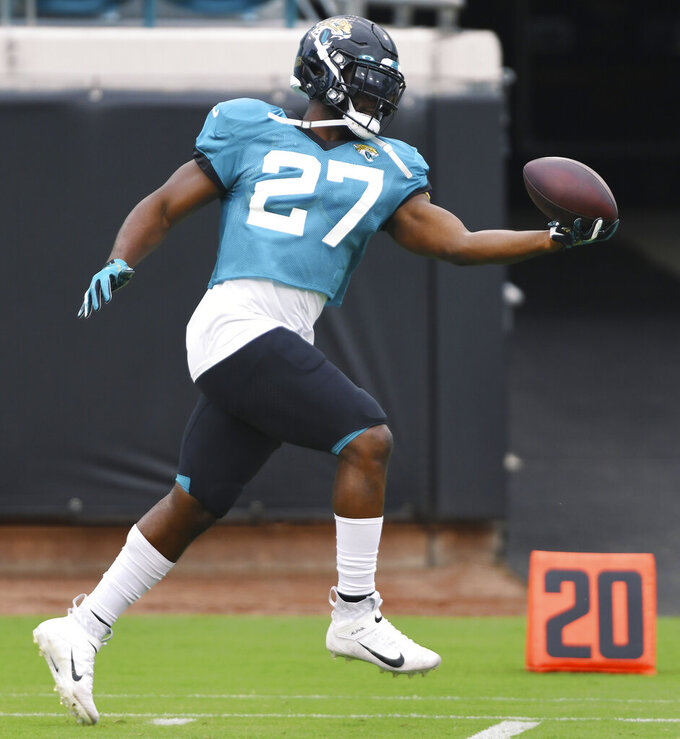 Jacksonville Jaguars running back Leonard Fournette pulls in a one-handed catch during NFL football training camp, Saturday, Aug. 29, 2020, in Jacksonville, Fla. (Bob Self/The Florida Times-Union via AP)