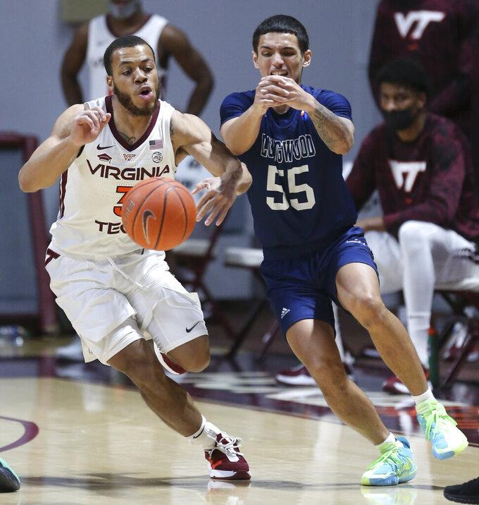 Virginia Tech's Wabissa Bede (3) steals a pass intended for Longwood's Juan Munoz (55) in the first half of an NCAA college basketball game in Blacksburg, Va., Monday, Dec. 21, 2020. (Matt Gentry/The Roanoke Times via AP, Pool)