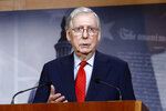 FILE - In this April 21, 2020, file photo Senate Majority Leader Mitch McConnell of Ky., speaks with reporters after the Senate approved a nearly $500 billion coronavirus aid bill on Capitol Hill in Washington. The Senate is set to resume Monday, May 4. (AP Photo/Patrick Semansky, File)