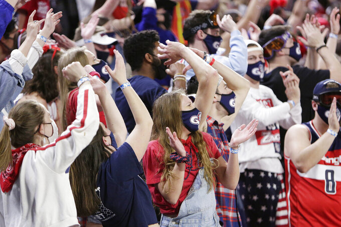 Gonzaga fans react during team introductions of the NCAA Final Four college championship basketball game between Gonzaga and Baylor during a watch party at the McCarthey Athletic Center in Spokane, Wash., Monday, April 5, 2021. (AP Photo/Young Kwak)