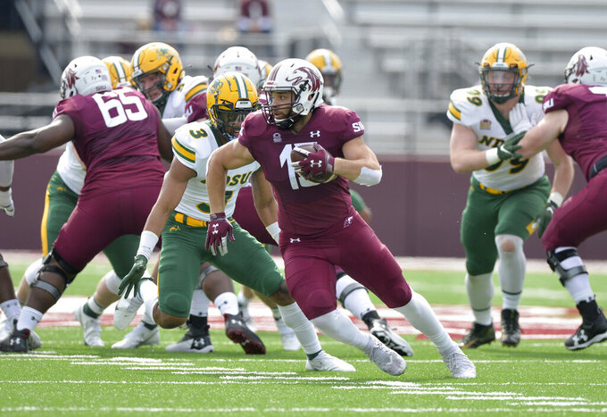 Southern Illinois running back Javon Williams Jr. (15) looks to avoid North Dakota State linebacker Jasir Cox (3) during the first quarter of an NCAA college football game Saturday, Feb. 29, 2021, in Carbondale, Ill. (Byron Hetzler/The Southern Illinoisan via AP)