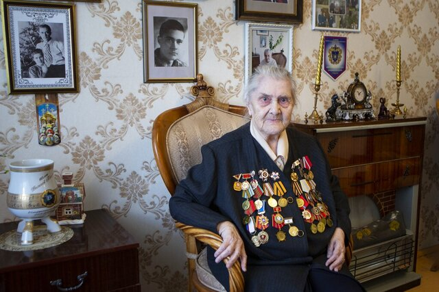In this photo taken on Thursday, April 30, 2020, Valentina Efremova, a World War II veteran, who served as a nurse in field hospitals on the frontlines throughout the war, speaks during her interview with the Associated Press in Yakutsk, Russia. For Russian World War II veteran Valentina Efremova, the coronavirus pandemic is like going through the war all over again. After the war, the 96-year-old said,