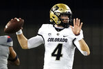Colorado quarterback Sam Noyer (4) looks to pass against Arizona in the first half during an NCAA college football game, Saturday, Dec. 5, 2020, in Tucson, Ariz. (AP Photo/Rick Scuteri)