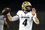 Colorado quarterback Sam Noyer (4) looks to pass against Arizona in the first half during an NCAA college football game, Saturday, Dec. 5, 2020, in Tucson, Ariz. (AP Photo/Rick Scuteri)