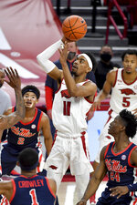 Arkansas guard Jalen Tate (11) pulls up to shoot against Mississippi during the first half of an NCAA college basketball game Wednesday, Jan. 27, 2021, in Fayetteville, Ark. (AP Photo/Michael Woods)