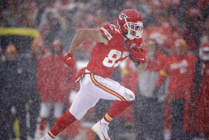 Kansas City Chiefs tight end Travis Kelce (87) carries the ball during the first half of an NFL football game against the Denver Broncos in Kansas City, Mo., Sunday, Dec. 15, 2019. (AP Photo/Charlie Riedel)