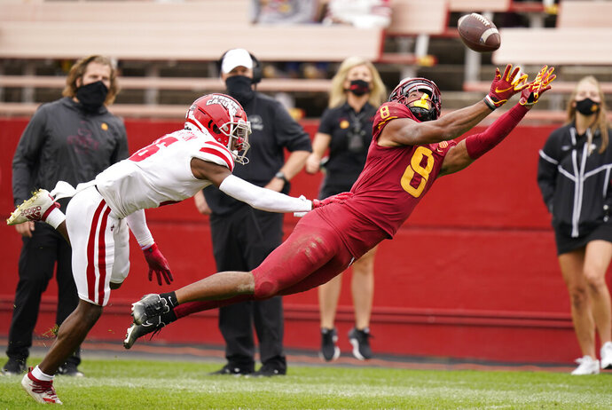 Iowa State wide receiver Xavier Hutchinson (8) makes a diving attempt to catch the ball ahead of Louisiana-Lafayette cornerback Asjlin Washington, left, during the second half of an NCAA college football game, Saturday, Sept. 12, 2020, in Ames, Iowa. The pass fell incomplete. Louisiana-Lafayette won 31-14. (AP Photo/Charlie Neibergall)