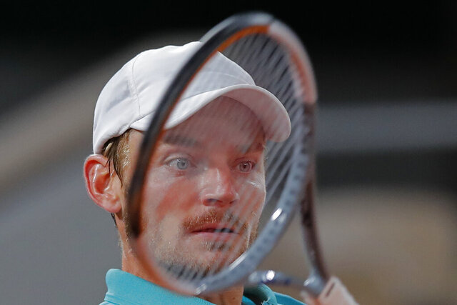 Belgium's David Goffin plays a shot against Italy's Jannik Sinner in the first round match of the French Open tennis tournament against at the Roland Garros stadium in Paris, France, Sunday, Sept. 27, 2020. (AP Photo/Christophe Ena)