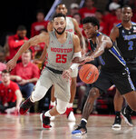 Houston guard Galen Robinson Jr. (25) goes for the ball as Memphis guard Kareem Brewton Jr. (5) works to keep control during the second half of an NCAA college basketball game Sunday, Jan. 6, 2019, in Houston. (AP Photo/Michael Wyke)