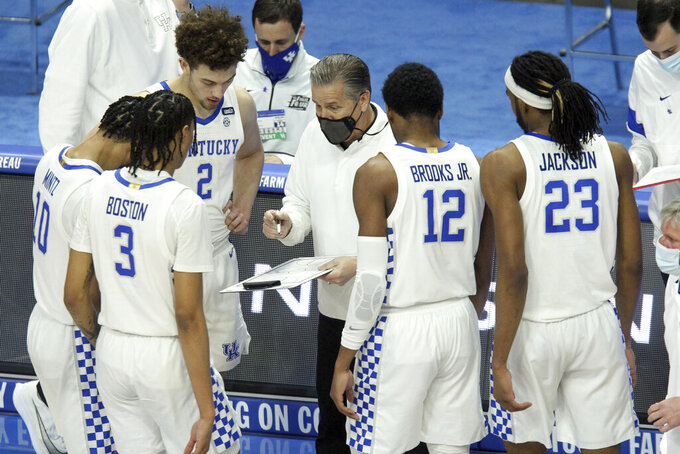 Kentucky head coach John Calipari, center, draws up a play during the first half of an NCAA college basketball game against South Carolina in Lexington, Ky., Saturday, March 6, 2021. (AP Photo/James Crisp)
