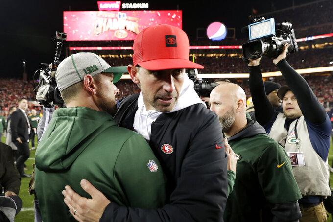 San Francisco 49ers head coach Kyle Shanahan, right, hugs Green Bay Packers head coach Matt LaFleur after the 49ers win in the NFL NFC Championship football game Sunday, Jan. 19, 2020, in Santa Clara, Calif. The 49ers won 37-20 to advance to Super Bowl 54 against the Kansas City Chiefs. (AP Photo/Matt York)