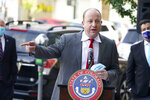 FILE - In this Thursday, Oct. 15, 2020, file photo, Colorado Governor Jared Polis makes a point during a news conference about the state's efforts to protect the process of casting a vote in the upcoming general election in downtown Denver. Colorado Gov. Jared Polis is quarantining himself after learning that Aurora Mayor Mike Coffman tested positive for the coronavirus. Coffman's diagnosis on Sunday, Oct. 25, 2020, came over a week after he and the governor appeared with other officials at a press conference. A Polis spokesperson said the governor would quarantine while waiting to hear from contact tracers. Coffman said he worked from home starting Thursday after not feeling well and his symptoms were gone by Saturday. He says he got a rapid test Sunday in hopes of being cleared to return to his office and schedule but will now quarantine at home. (AP Photo/David Zalubowski, File)