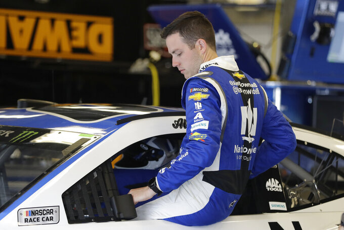 Monster Energy NASCAR Cup Series driver Alex Bowman climbs into his car during practice for the NASCAR Brickyard 400 auto race at the Indianapolis Motor Speedway, Saturday, Sept. 7, 2019 in Indianapolis. (AP Photo/Darron Cummings)