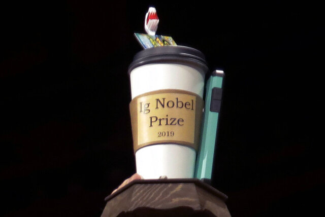FILE - In this Sept. 12, 2019, file photo, the 2019 Ig Nobel award is displayed at the 29th annual Ig Nobel awards ceremony at Harvard University in Cambridge, Mass. The spoof prizes for weird and sometimes head-scratching scientific achievement will be presented online in 2020 due to the coronavirus pandemic. (AP Photo/Elise Amendola, File)