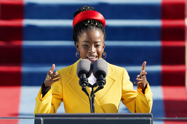 American poet Amanda Gorman reads a poem during the 59th Presidential Inauguration at the U.S. Capitol in Washington, Wednesday, Jan. 20, 2021. (AP Photo/Patrick Semansky, Pool)