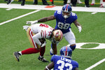 San Francisco 49ers' Fred Warner, left, intercepts a ball thrown by New York Giants quarterback Daniel Jones during the first half of an NFL football game, Sunday, Sept. 27, 2020, in East Rutherford, N.J. (AP Photo/Corey Sipkin)
