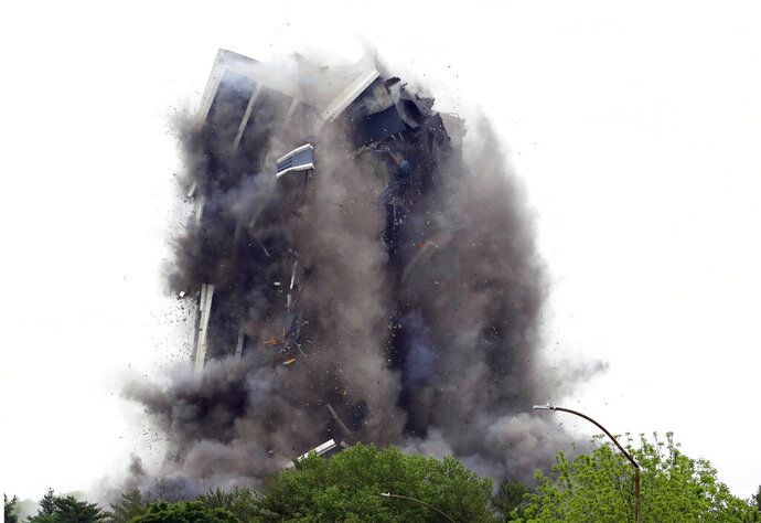 Martin Tower, former world headquarters of Bethlehem Steel, implodes Sunday May 19, 2019 in Bethlehem, Pa. Crowds gathered to watch the demolition of the area's tallest building, a 21-story monolith that opened at the height of Bethlehem Steel's power and profitability but had stood vacant for a dozen years after America's second-largest steelmaker went out of business. (AP Photo/Jacqueline Larma)