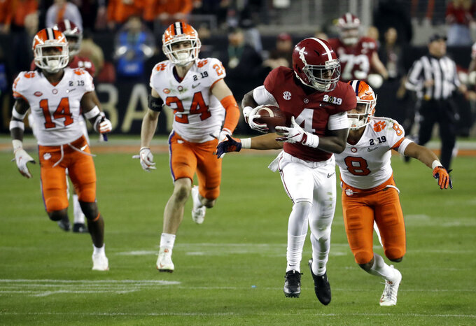 Alabama's Jerry Jeudy catches a pass in front of Clemson's A.J. Terrell during the second half of the NCAA college football playoff championship game, Monday, Jan. 7, 2019, in Santa Clara, Calif. (AP Photo/Chris Carlson)