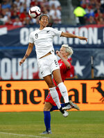 FILE - In this May 16, 2019, file photo, New Zealand's Abby Erceg (8) reaches for the ball as United States' Megan Rapinoe defends during the first half of an international friendly soccer match in St. Louis. Coach Paul Riley calls defender Abby Erceg the bedrock of the North Carolina Courage. The New Zealand native is captain of the Courage, the two-time National Women's Soccer League defending champions. (AP Photo/Jeff Roberson, File)
