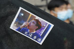 A sticker featuring a picture of Hong Kong activist Edward Leung with Chinese words which read