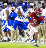 Alabama wide receiver DeVonta Smith (6) makes a catch against Kentucky defensive back Brandin Echols (26) during an NCAA college football game Saturday, Nov. 21, 2020, in Tuscaloosa, Ala. (Mickey Welsh/The Montgomery Advertiser via AP)