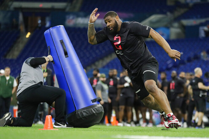 FILE - In this Feb. 29, 2020, file photo, TCU defensive lineman Ross Blacklock runs a drill at the NFL football scouting combine in Indianapolis. Blacklock was selected by the Houston Texans in the second round of the NFL football draft Friday, April 24, 2020. (AP Photo/Michael Conroy)