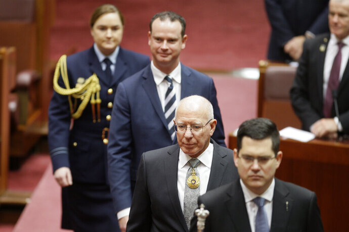 Former soldier David Hurley, second from bottom, is sworn in as Australia's governor-general at a ceremony in Parliament House in Canberra Monday, July 1, 2019. Hurley will officiate on Tuesday when Parliament resumes for the first time since Prime Minister Scott Morrison's conservative government was elected to a third three-year term. (AP Photo/Rod McGuirk)