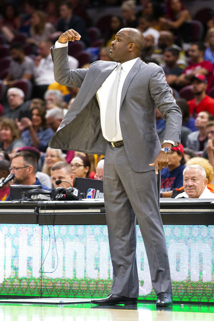 Indiana Pacers head coach Nate McMillan signals to his players during the second quarter against the Cleveland Cavaliers during a preseason NBA basketball game, Monday, Oct. 8, 2018, in Cleveland. (AP Photo/Scott R. Galvin).