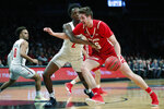 Wisconsin forward Nate Reuvers (35) drives around Richmond forward Souleymane Koureissi (2) during the first half of an NCAA college basketball game in the Legends Classic, Monday, Nov. 25, 2019, in New York. (AP Photo/Kathy Willens)