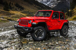 This undated photo provided by Fiat Chrysler shows a 2019 Jeep Wrangler. The SUV can be a capable off-roader or a rugged-looking boulevard cruiser. It's still the only SUV available that has a removable roof and doors. (Fiat Chrysler via AP)