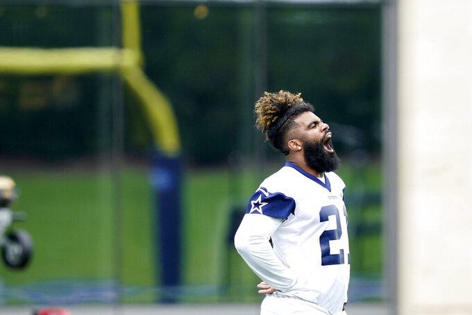 Dallas Cowboys running back Ezekiel Elliott (21) warms up during an NFL football team practice Wednesday, June 9, 2021, in Frisco, Texas. (AP Photo/LM Otero)