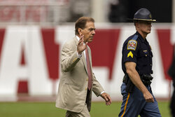 Alabama head coach Nick Saban waves to fans on his arrival before an NCAA college football game against Mississippi, Saturday, Oct. 2, 2021, in Tuscaloosa, Ala. (AP Photo/Vasha Hunt)