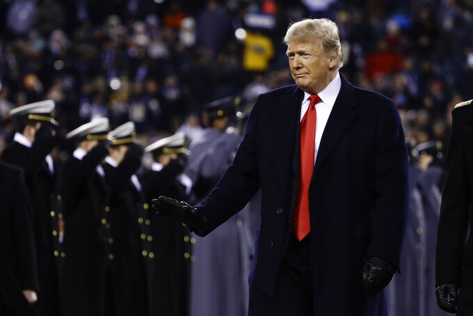 President Donald Trump crosses the field after the first half of an NCAA college football game between the Army and the Navy, Saturday, Dec. 8, 2018, in Philadelphia. (AP Photo/Matt Rourke)