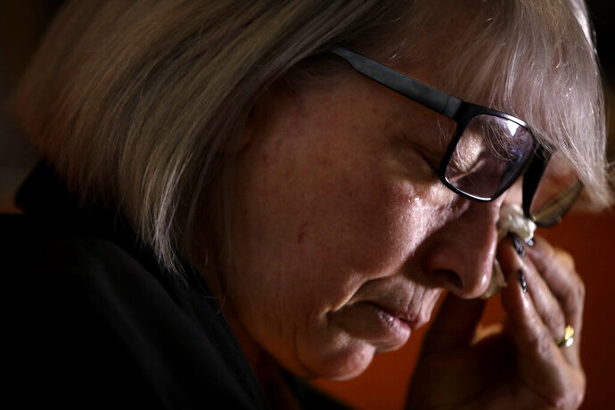 In this picture taken on Friday, Jan. 31, 2020 Yolanda Martinez Garcia cries during an interview with the Associated Press at her home, in Milan. Her son was sexually abused by one of the priests of the Legion of Christ, a disgraced religious order. (AP Photo/Luca Bruno)