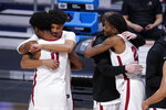 Alabama players hug after losing to UCLA 88-86 in overtime in a Sweet 16 game in the NCAA men's college basketball tournament at Hinkle Fieldhouse in Indianapolis, Sunday, March 28, 2021. (AP Photo/Michael Conroy)