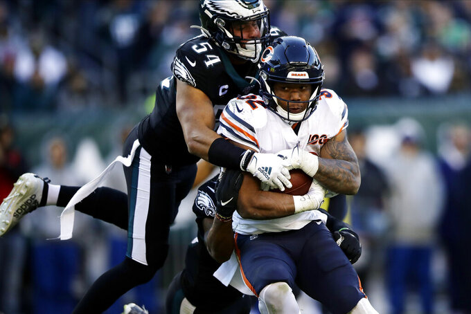 Chicago Bears' David Montgomery (32) tries to break free of Philadelphia Eagles' Kamu Grugier-Hill (54) during the second half of an NFL football game, Sunday, Nov. 3, 2019, in Philadelphia. (AP Photo/Matt Rourke)
