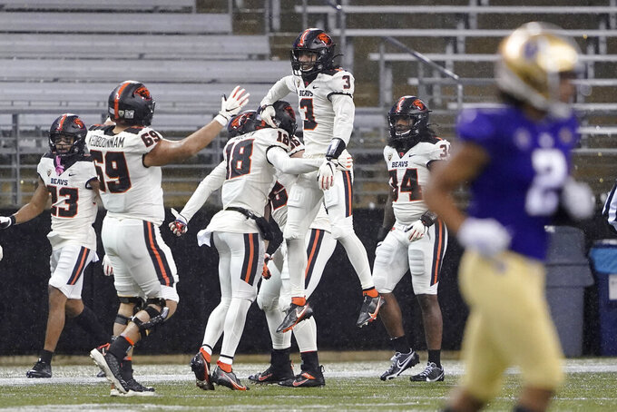 Oregon State's Jaydon Grant (3) celebrates with teammates after he picked up a blocked Washington punt and scored a touchdown during the first half of an NCAA college football game Saturday, Nov. 14, 2020, in Seattle. (AP Photo/Ted S. Warren)
