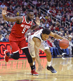 Louisville forward Dwayne Sutton (24) drives past North Carolina State guard Eric Lockett (5) during the second half of an NCAA college basketball game in Louisville, Ky., Thursday, Jan. 24, 2019. Louisville won 84-77. (AP Photo/Timothy D. Easley)