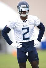 Tennessee Titans wide receiver Julio Jones rests between drills during an NFL football practice Thursday, June 10, 2021, in Nashville, Tenn. (George Walker IV/Pool Photo via AP)