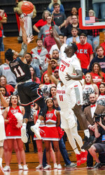 Gardner Webb guard David Efianayi (11) shoots over Radford defender MawdoSallah (20) during the first half of the Big South conference NCAA basketball championship game in Radford, Va., Sunday, March 10, 2019. (AP Photo/Lee Luther Jr.)