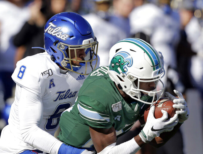 Tulane wide receiver Jaetavian Toles (82) snags a pass in front of Tulsa safety Brandon Johnson (8) during an NCAA college football game in New Orleans, La., Saturday, Nov. 2, 2019. (A.J. Sisco/The Advocate via AP)