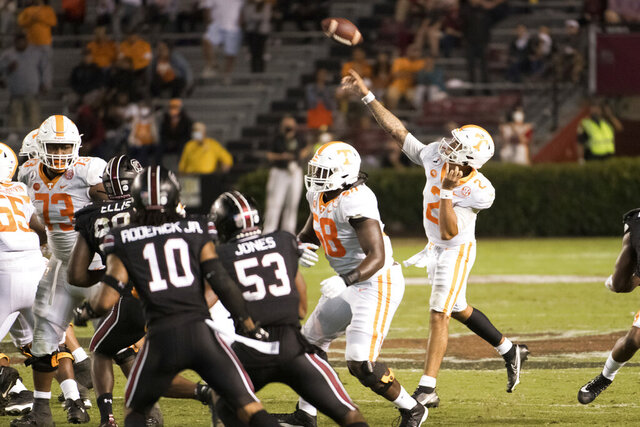 Tennessee quarterback Jarrett Guarantano (2) throws a touchdown pass during the second half of the team's NCAA college football game against South Carolina on Saturday, Sept. 26, 2020, in Columbia, S.C. (AP Photo/Sean Rayford)
